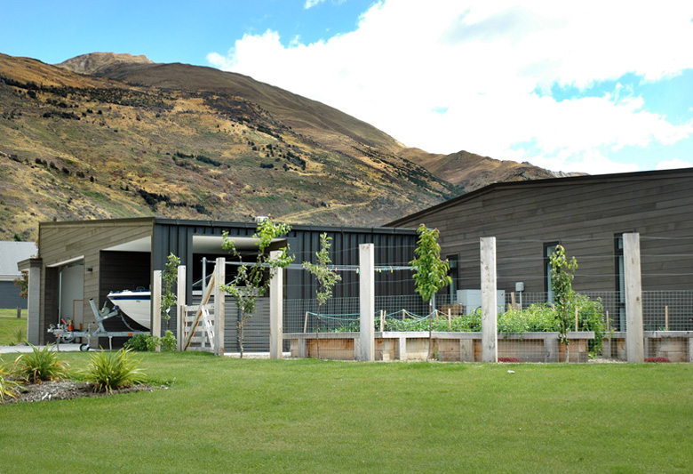 Shot of garage and garden with a view of Mount Roy in Wanaka