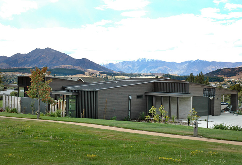 Long shot of house with background of Wanaka's mountains