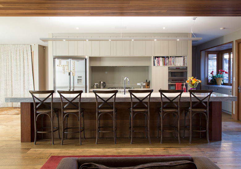 Stools lined up at kitchen bench