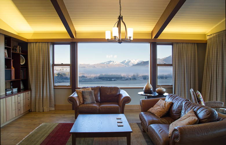 Picture of living room with view of Wanaka's mountain ranges through the window