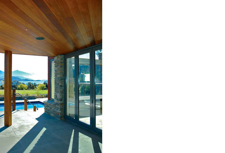 House's outdoor area looking towards pool and over to Lake Wanaka