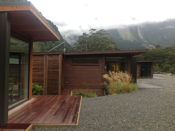 A row of Milford Sound Lodge's cabins