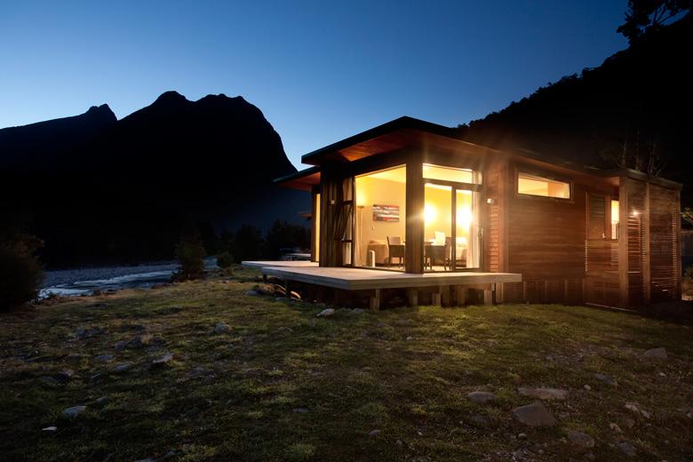 Illuminated cabin at night