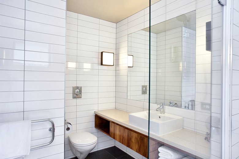 A bathroom's toilet and hand basin
