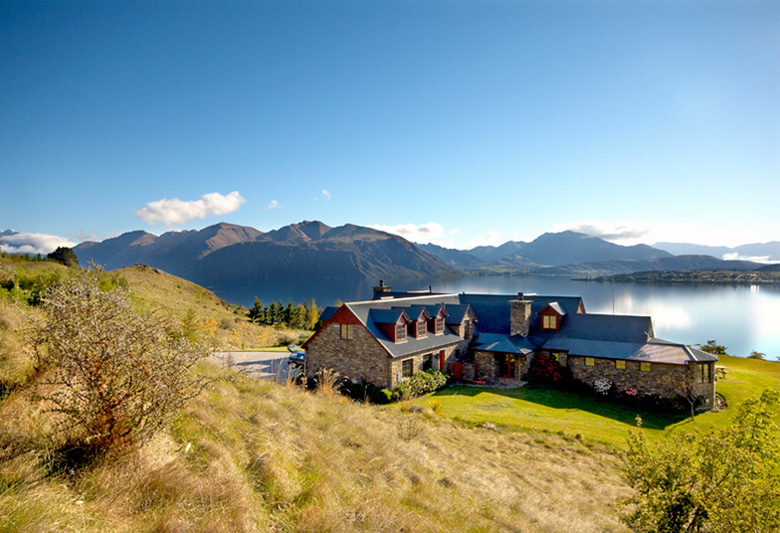 Long shot of Mount Aspiring Rd residence overlooking Lake Wanaka and surrounding mountains