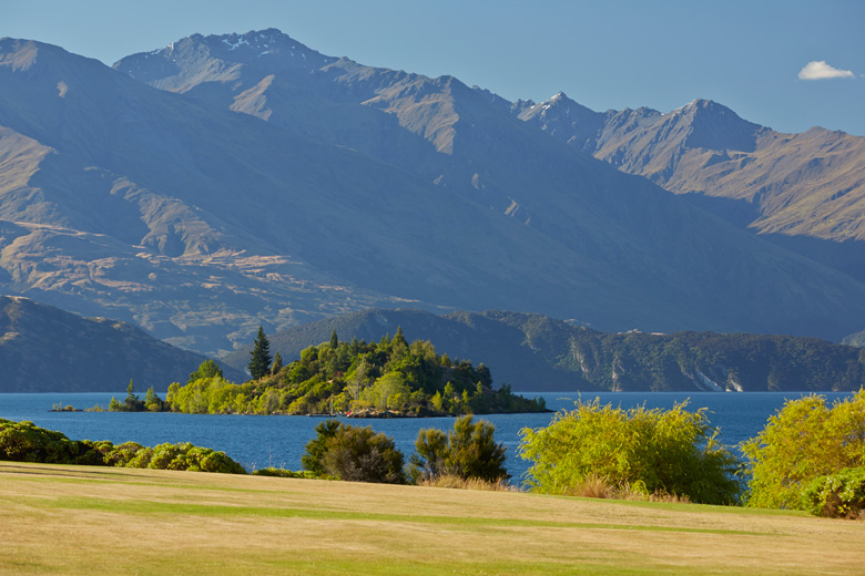 View of Lake Wanaka's Ruby Island from the lawn at Sunrise Bay