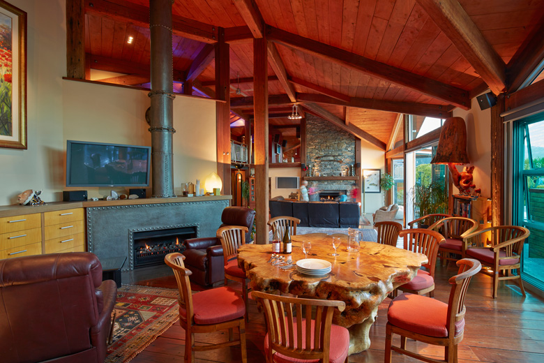 Picture of dining area with a view of open fire and living area