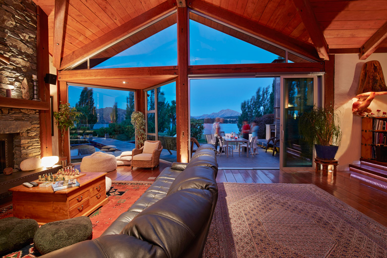 Picture of living room with view of pool, courtyard and Lake Wanaka