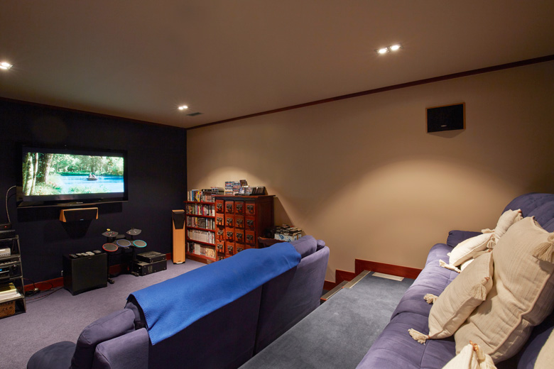 Picture of home theater room with tiered sofa levels