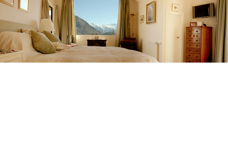 Picture of master bedroom with view out to Wanaka's Mount Roy