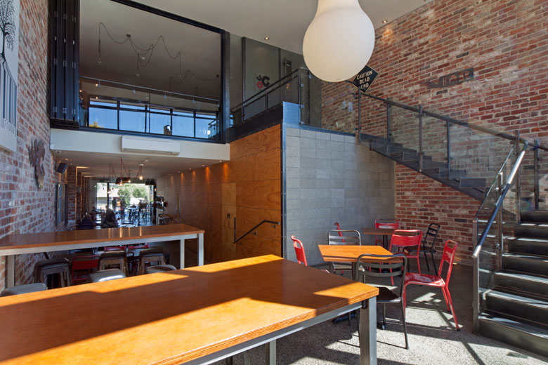 Picture of Urban Grind's back area, staircase and bar entrance