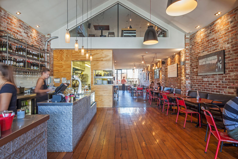 View of Urban Grind's bar, kitchen and main dining area