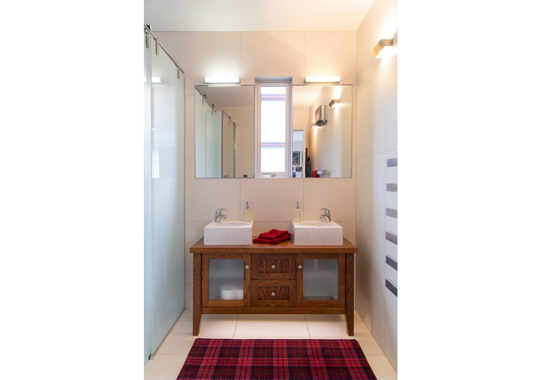 Photo of bathroom with mirror and twin basins