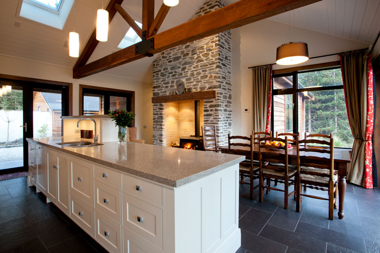 Kitchen bench overlooking dinning table and open fire place