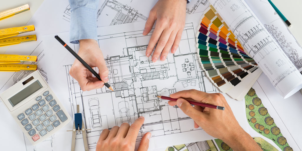 Two people discussing over an architectural floor plan