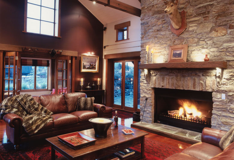 Picture of living room with open fire and exposed rafters