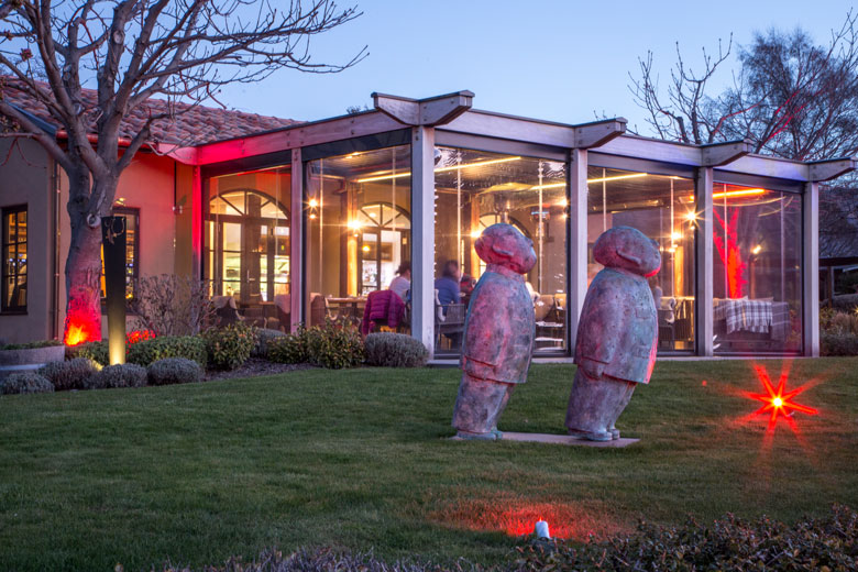 Bisto Gentil's front lawn statues in the evening