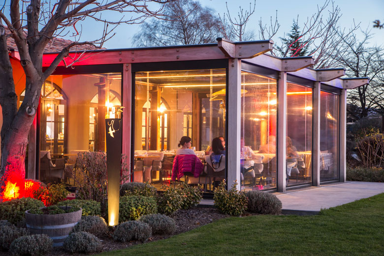 Bistro Gentil's indoor outdoor courtyard in the evening