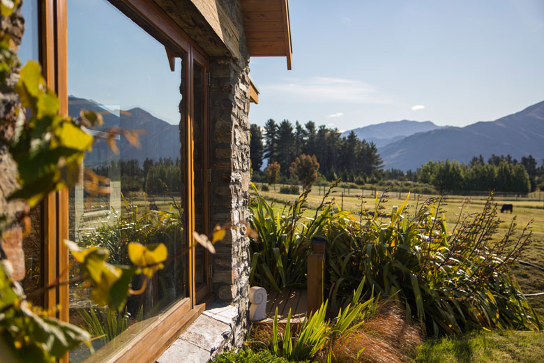 View of window looking over farmland and mountains