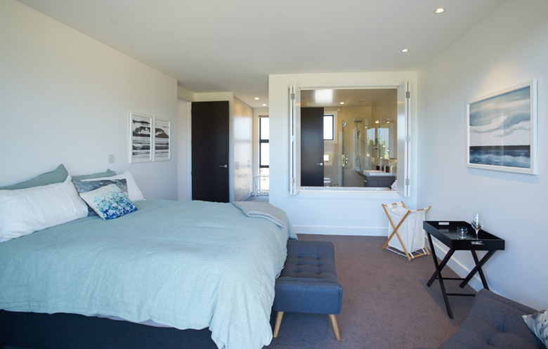 Photo of bed room with view into bathroom