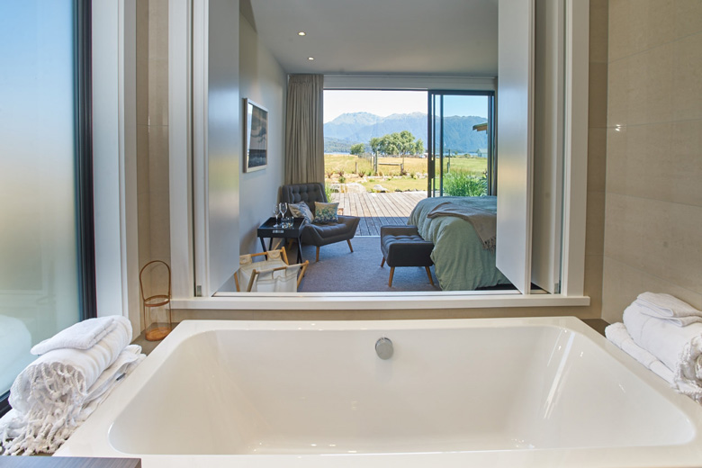 Image of bath with view of bedroom