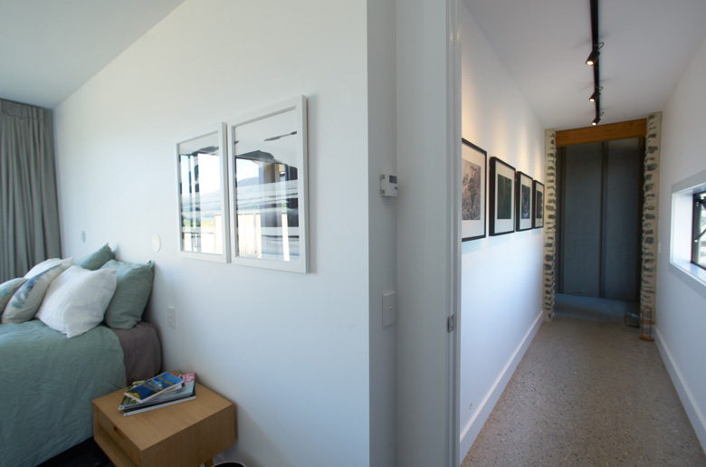 Photo of bed and hallway