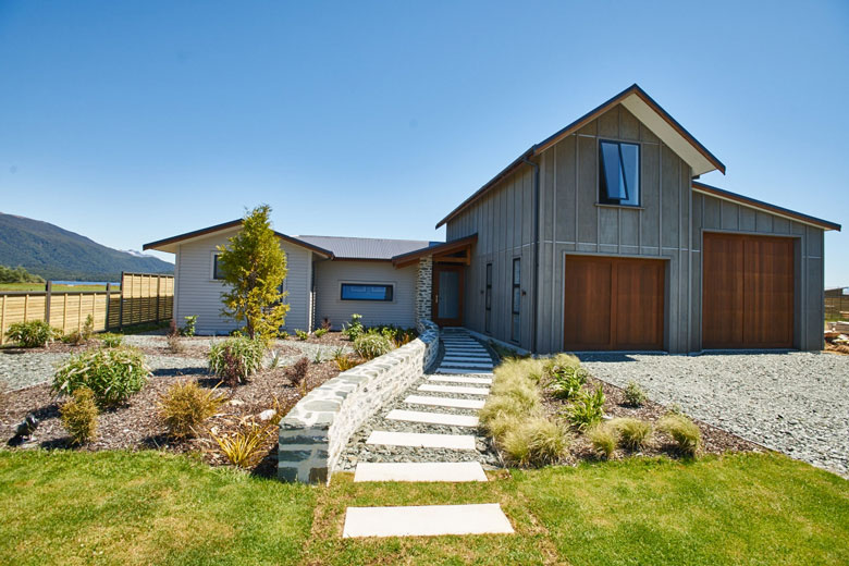 Garage view of Te Anau house with walkway to door