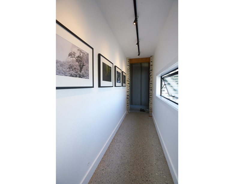 Image of hallway lined with framed photos