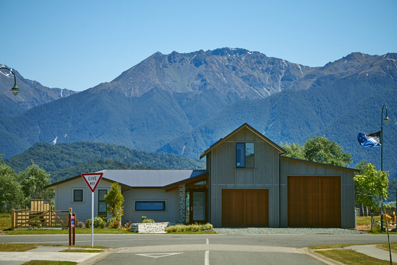 Picture of house from street with view of mountains in background