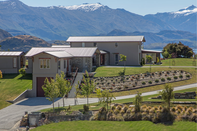 Picture of Ridgecrest house with mountains in background