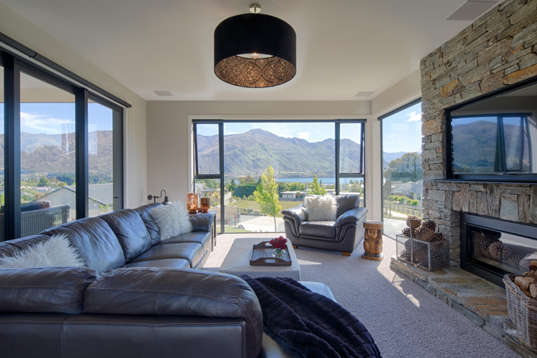 Photo of home's living room with view of lake