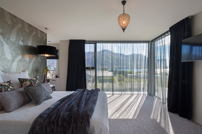 Image of bed with view out window
