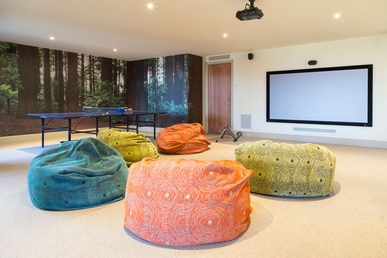 Image of bean bags on floor in front of projector screen