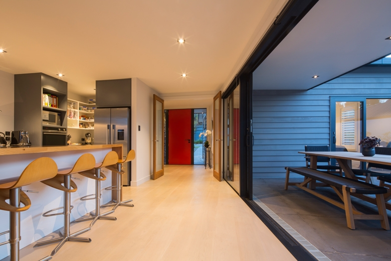Kitchen with sliding doors opened to the patio