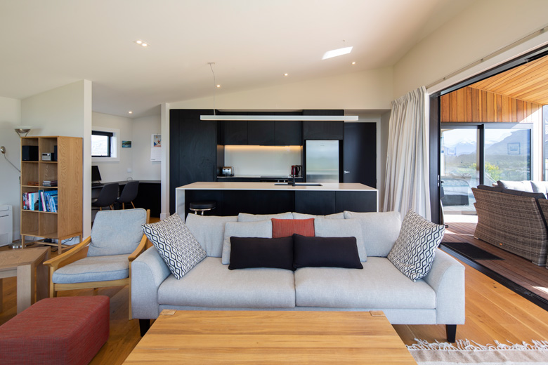 Picture of couch with kitchen in background