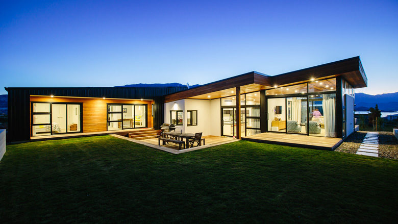 Photo of Urquhart Place residence at dusk