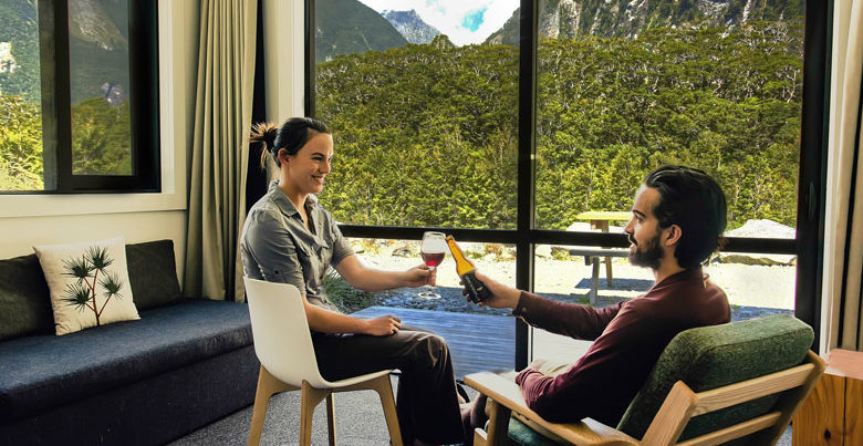 Picture of couple in room overlooking mountains in Milford Sound